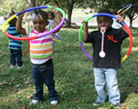 African American children playing with hula hoops