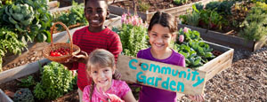 Three multicultural children in garden